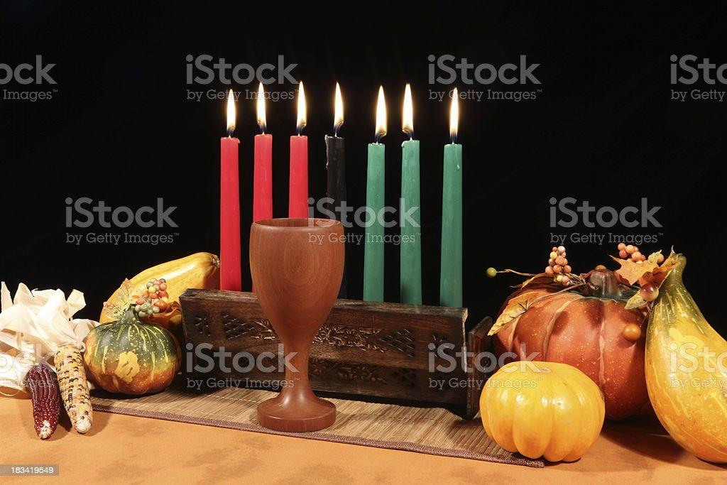 Kwanzaa Display on Black All Candles Lit stock photo