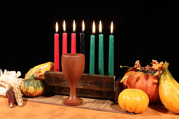 kwanzaa display on black all candles lit - kwanzaa stock pictures, royalty-free photos & images
