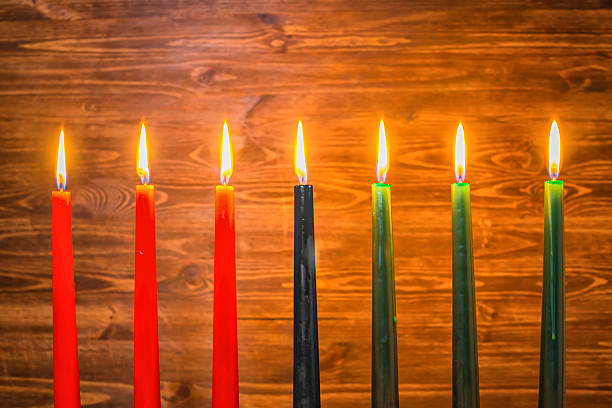 Kwanzaa festival concept with seven candles red, black and green - foto de stock