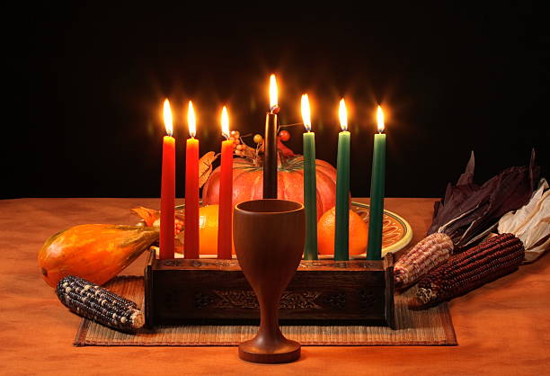 kwanzaa table candles glowing - kwanzaa stock pictures, royalty-free photos & images