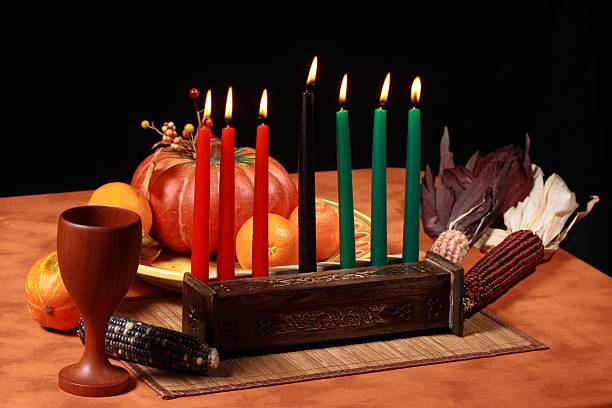 kwanzaa table candles lit - kwanzaa stock pictures, royalty-free photos & images