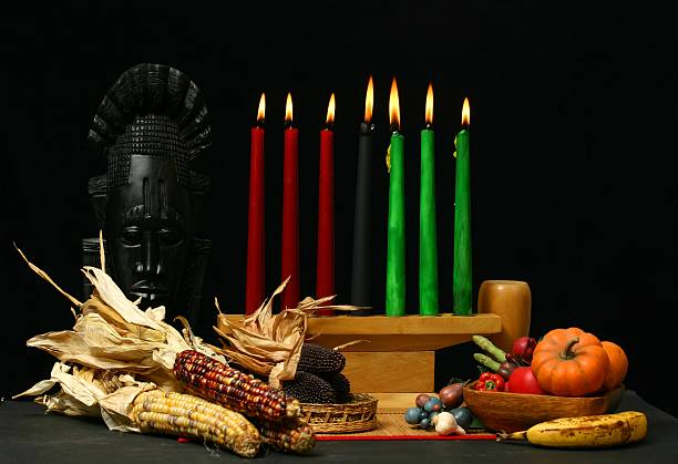 kwanzaa table setting with candle and dried corn cobs - kwanzaa stock pictures, royalty-free photos & images