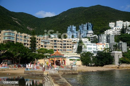 People in the background at Kwum Yam Shrine, a Taoist shrine by Repulse Bay beach, Hong Kong island South coastline busier tourist spot.