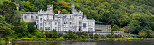 County Galway, Ireland - August 20th 2018: A panoramic view of the magnificent Kylemore Abbey - the Benedictine monastery in Connemara, County Galway, Ireland.