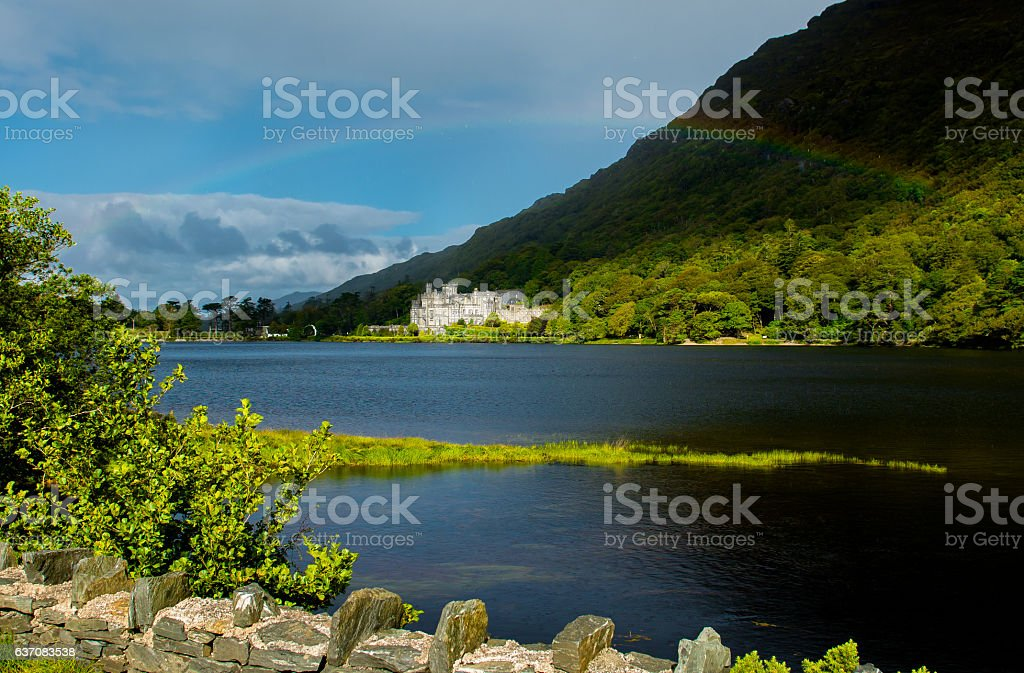 Kylemore Abbey in Ireland under a Rainbow stock photo