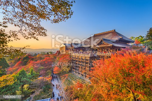 Kyoto, Japan - November 30, 2015: Visitors enjoy  Kiyomizu-dera during the autumn seasons. The temple was complete in the year 778 and is a UNESCO World Heritage Site.