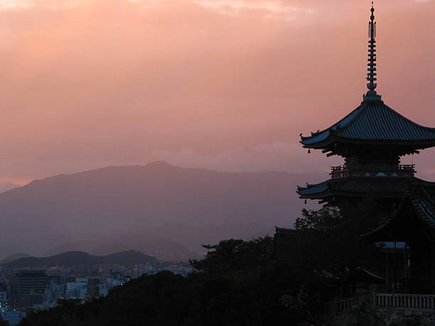 Kyoto palace at sunset This is a beautiful palace in Kyoto, Japan at sunset with the mountains and city in the background. pagoda stock pictures, royalty-free photos & images