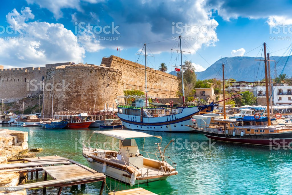 Kyrenia harbour overlooked by the fort. Kyrenia, Cyprus stock photo