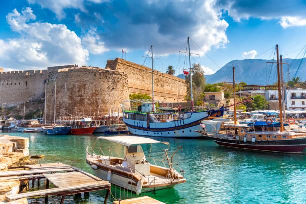 kyrenia harbour overlooked by the fort. kyrenia, cyprus - cyprus стоковые фото и изображения