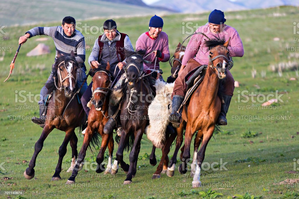 Kyrgiz horse riders playing the game known as goat polo, in Issyk Kul, Kyrgyzstan. stock photo