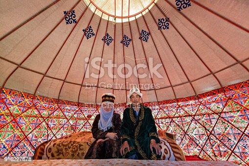 istock Kyrgyz couple in their yurt, Bishkek, Kyrgyzstan 916227678