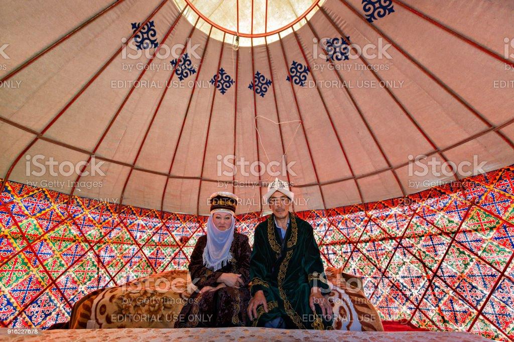 Kyrgyz couple in their yurt, Bishkek, Kyrgyzstan stock photo