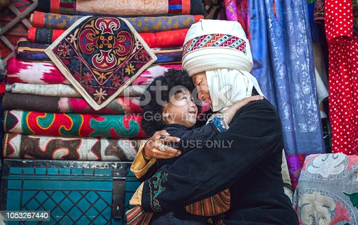 istock Kyrgyz mother and son at home 1053267440