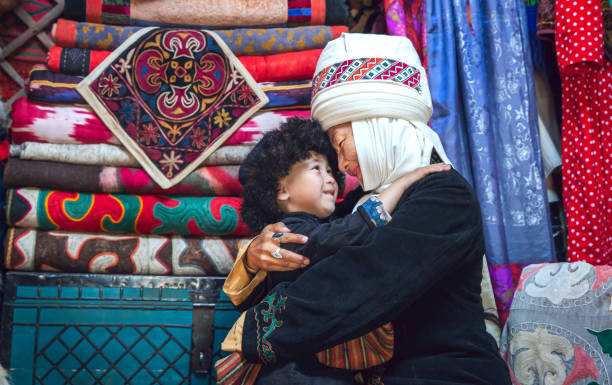 Kyrgyz mother and son at home stock photo