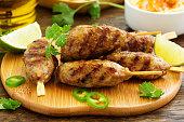 Kyufta (barbecue) of lamb with snacks (radish salad,