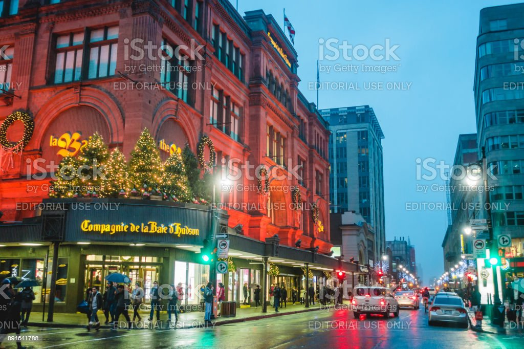 La Baie Store Front and Xmas Decorations on Ste-Catherine Street during a Christmas Shopping Rainy Night stock photo