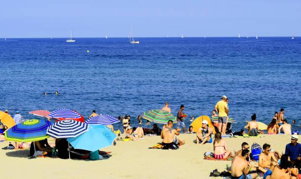 La Barceloneta beach crowded in Barcelona stock photo