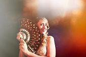 la belle with her hand fan