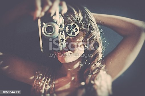 istock La belle with the old camera 1058544936