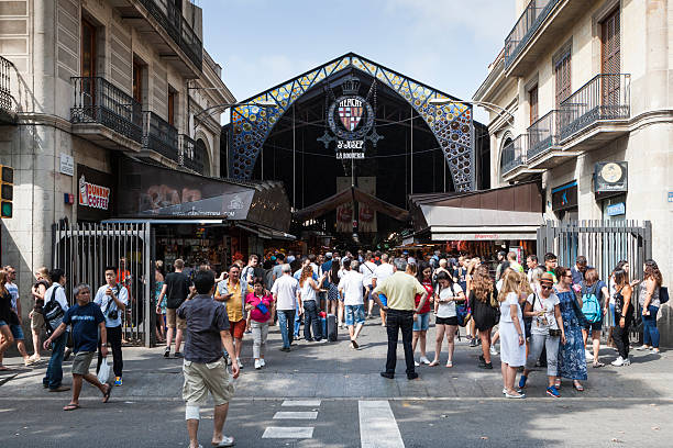 La Boqueria Barcelona, Spain - July 11, 2015: People in front of La Boqueria which is the famous food market hall in Barcelona market hall stock pictures, royalty-free photos & images