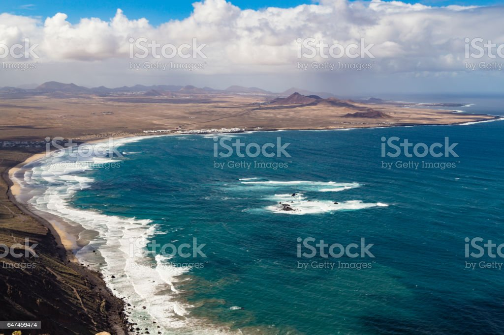 La Caleta de Famara and fire mountain, Lanzarote stock photo