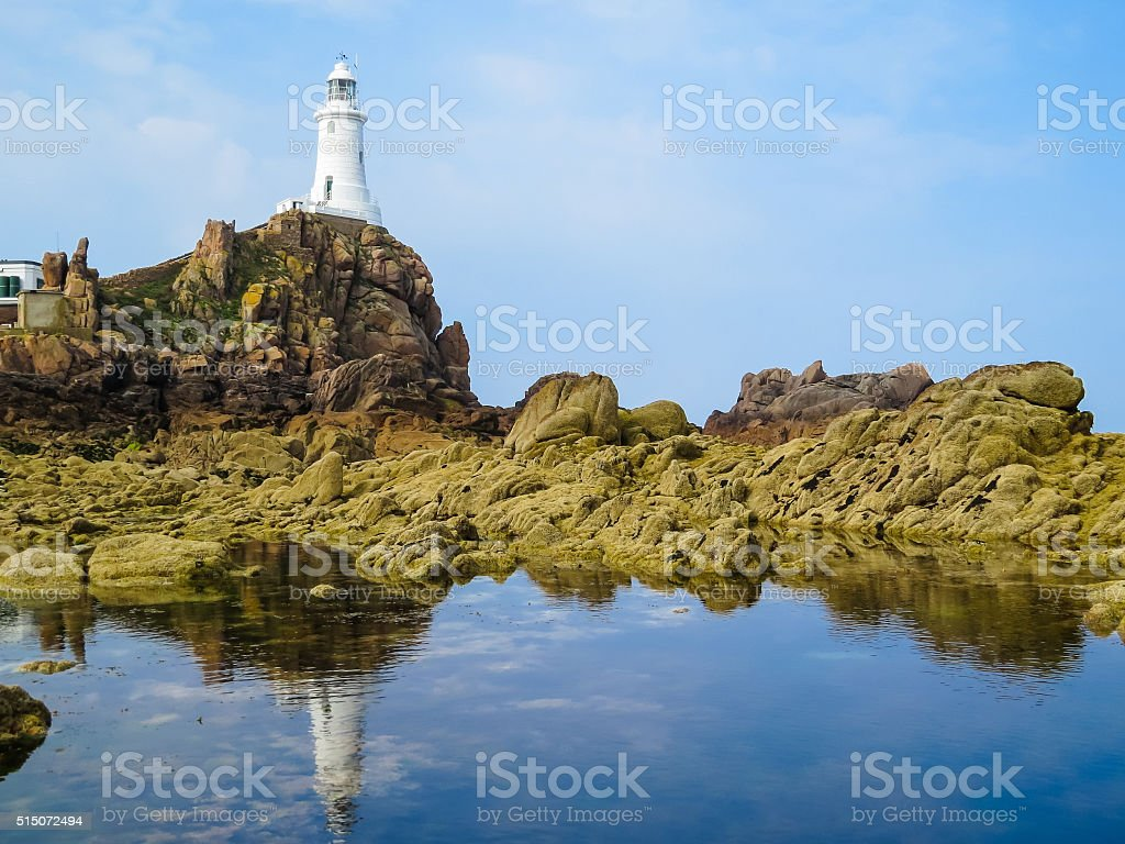 La Corbiere Lighthouse and reflection stock photo