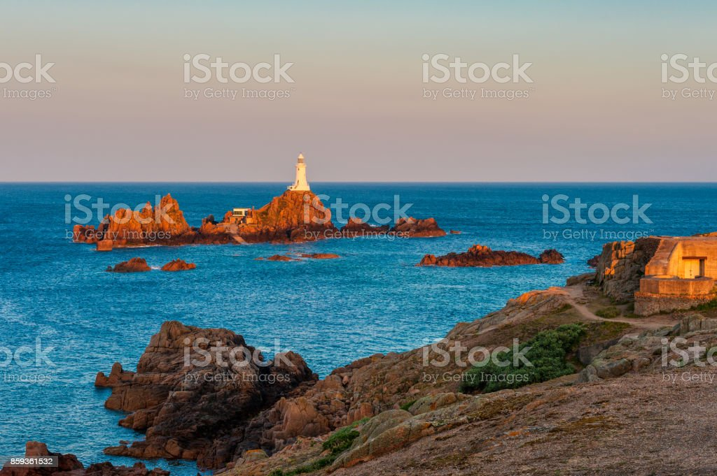La Corbiere Lighthouse Jersey at Sunrise and High Tide stock photo