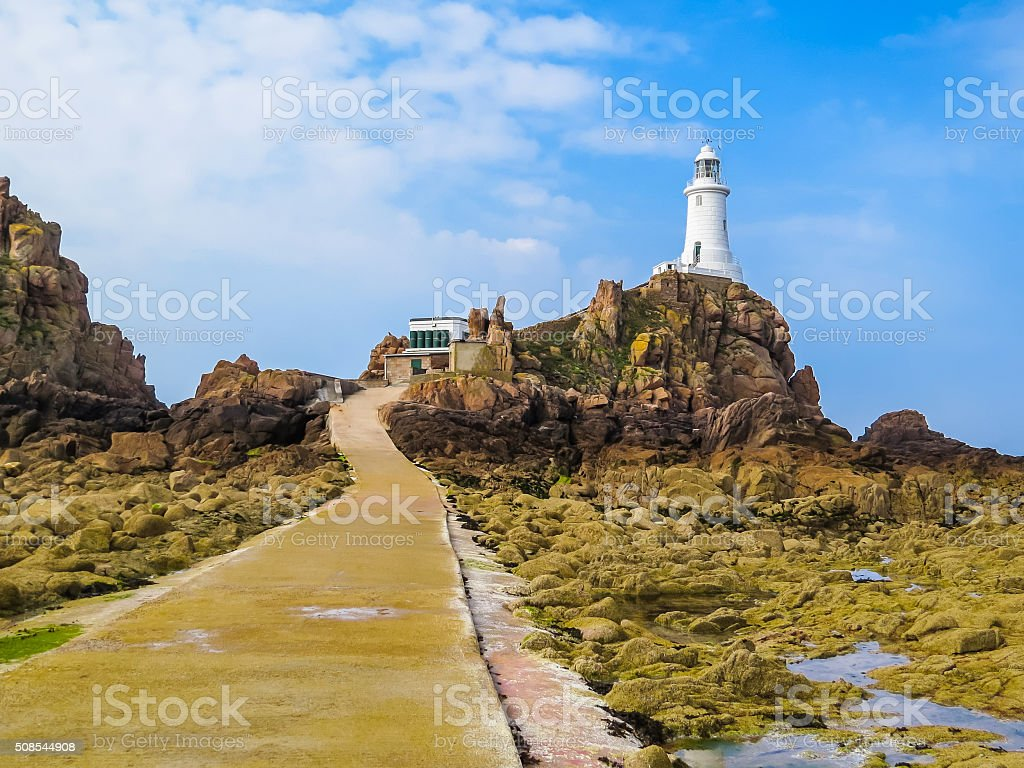 La Corbiere Lighthouse on the rocky coast of Jersey Island stock photo