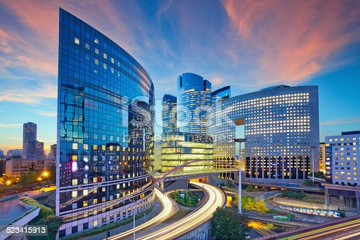 Image of office buildings in modern part of Paris- La Defense during sunset.