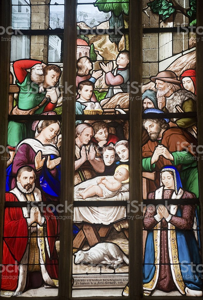 La Ferté-Bernard (France) - Gothic church interior, stained glass window royalty-free stock photo