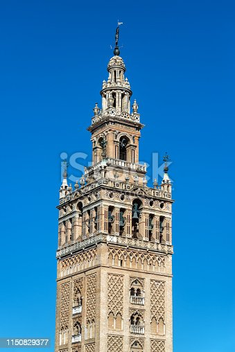 Medieval La Giralda bell tower of the Seville Cathedral in Seville, Spain