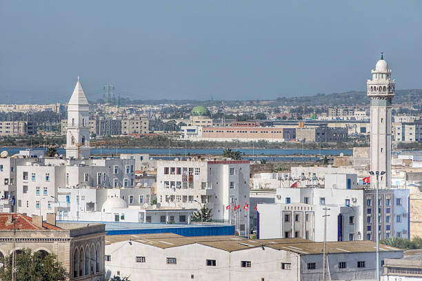 "La Goulette, Tunisia ""La Goulette (Halq al Wadi) is the main port for Tunis, the capital of Tunisia. Very minor blurring of background, due to heat rising from the city, hazy skies and telephoto DOF, with main focus on church and mosque towers.More in..."" davelongmedia stock pictures, royalty-free photos & images"