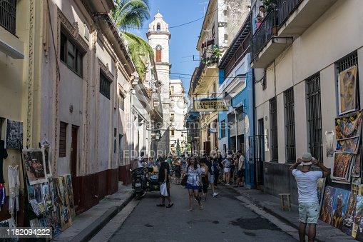 La Havana, Cuba – December 26, 2016:  street view with tourists in front of La Bodega de Medio, most famous bar in Cuba, general travel imagery