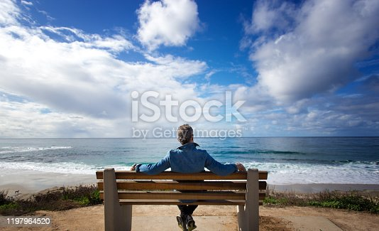 La Jolla, CA: Man Sitting on Bench Looking at Pacific Ocean