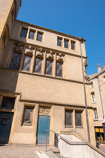 Metz, France - August 31, 2019: La Maison des Tetes la Fournirue or House of Heads of Metz is Renaissance style house known for her facade sculptures