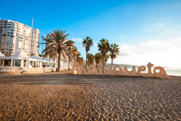 La Malagueta public beach (Playa de La Malagueta) at sunset stock photo