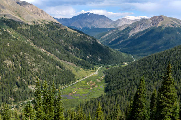 La Plata Peak - Summer view of Highway 82 winding in Lake Creek Valley at base of La Plata Peak, part of the Sawatch Range, seen from the summit of Independence Pass. Colorado, USA. stock photo