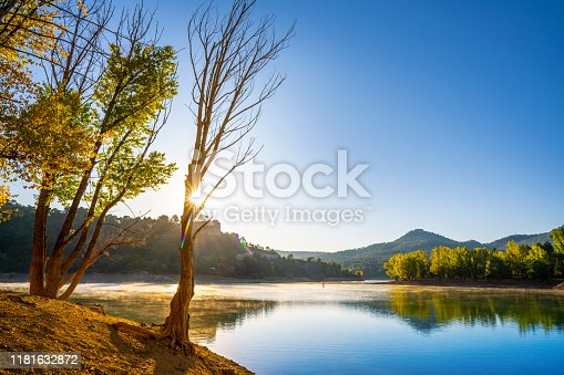La Toba reservoir of river Jucar in Cuenca Serrania of Spain sunrise in early autumn