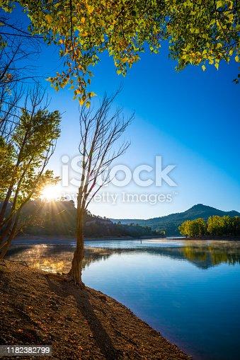 La Toba reservoir of river Jucar in Cuenca Serrania of Spain sunrise in early autumn