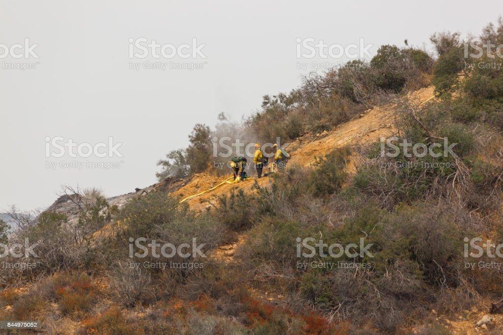 La Tuna wildfire in Los Angeles, CA burning a structure stock photo