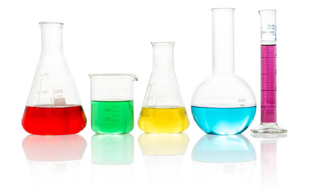 lab glassware filled with colorful liquid - foto stock