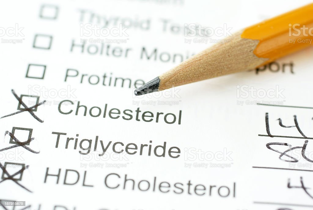 lab report for cholesterol with pencil stock photo