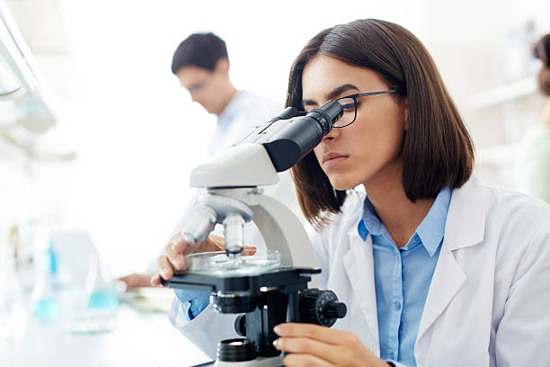 lab research - microscope stock photos and pictures