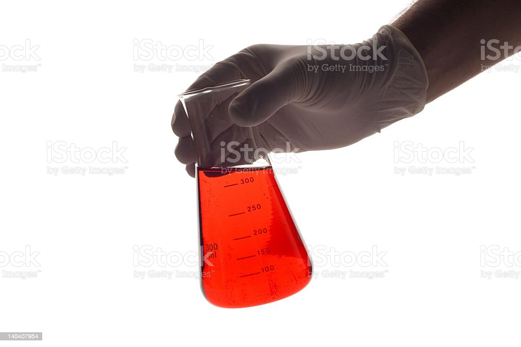 Lab technician holding a Erlenmeyer royalty-free stock photo