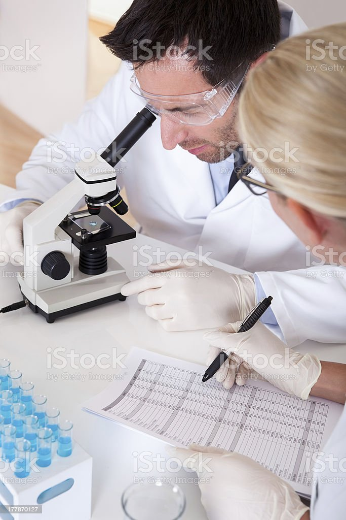 Lab technicians at work in a laboratory royalty-free stock photo