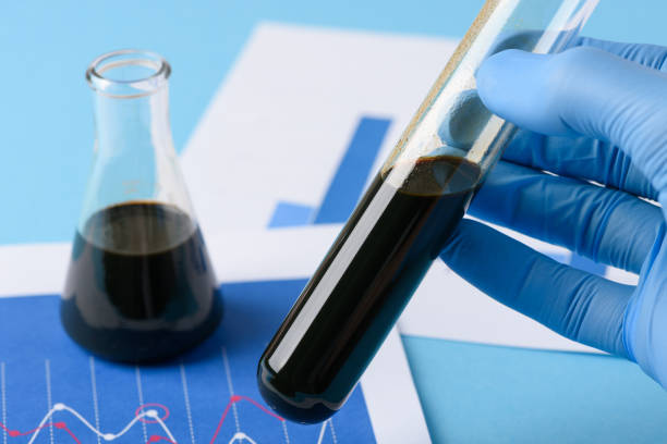 Lab test crude oil in vial in scientist hand