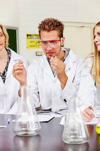 Lab trainee with safety glasses stock photo