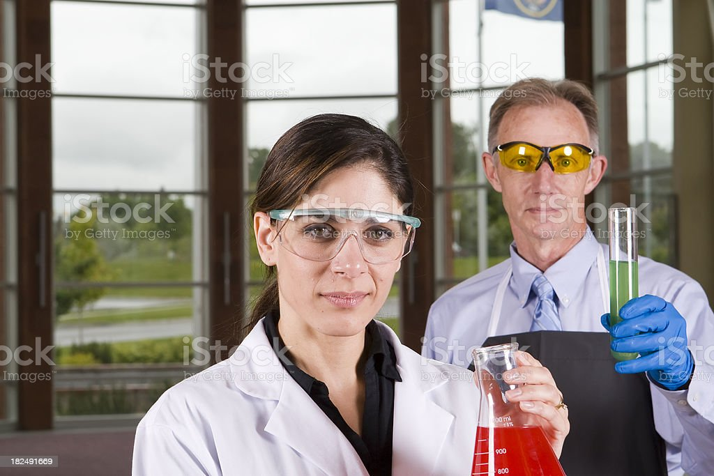 Lab workers holding flask and test tube royalty-free stock photo