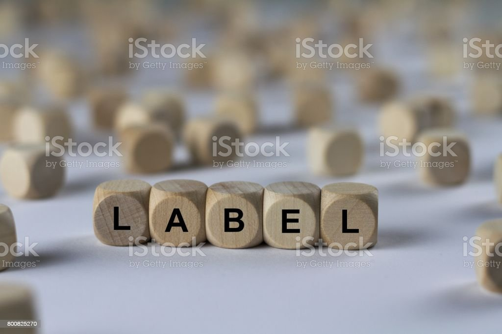 label - cube with letters, sign with wooden cubes stock photo