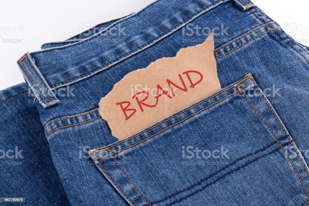 BRAND label in jeans pocket - Foto stock royalty-free di Abbigliamento casual